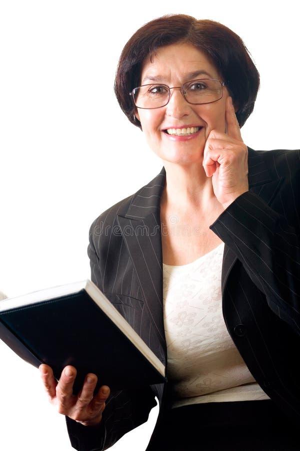 Rijpe gelukkige bedrijfsvrouw stock fotografie