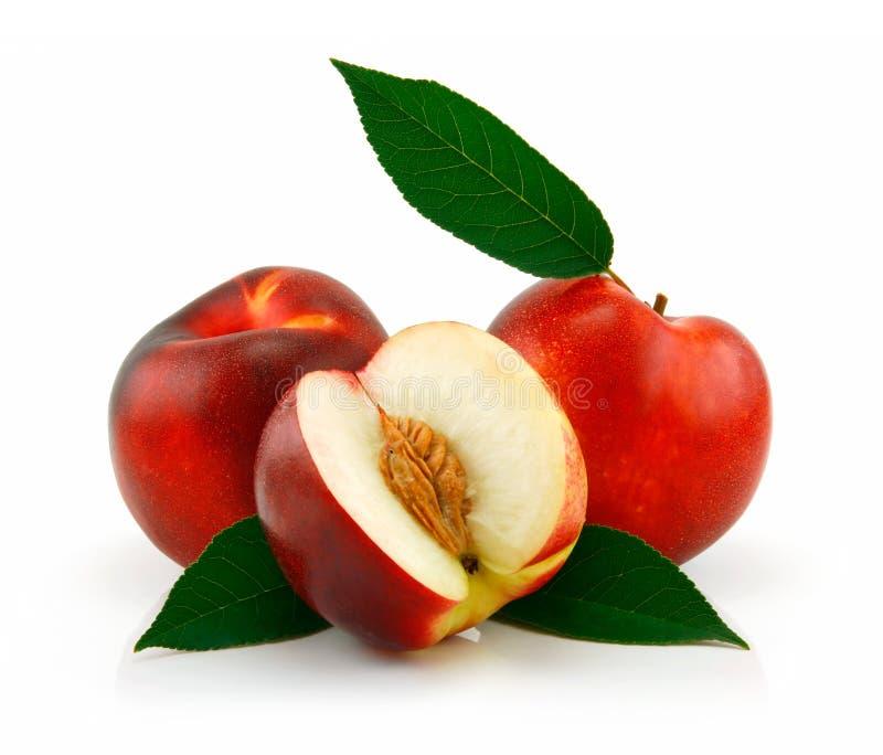 Rijpe Gesneden Perzik (Nectarine) stock afbeeldingen