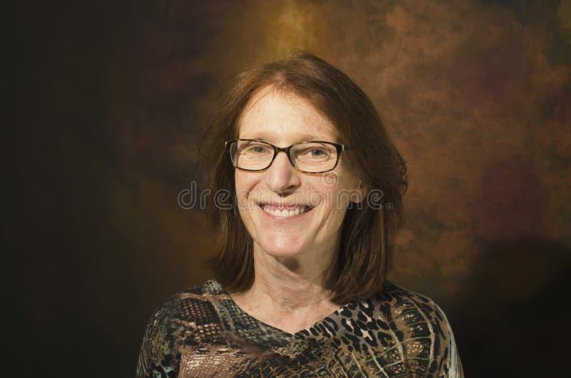 Rijpe glimlachende roodharigevrouw royalty-vrije stock afbeelding