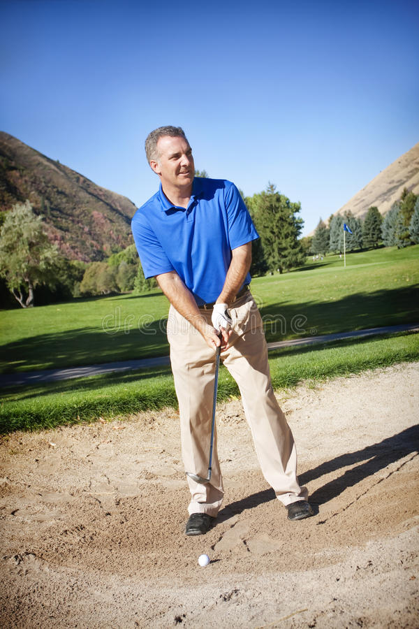 Rijpe Mannelijke Golfspeler stock afbeeldingen