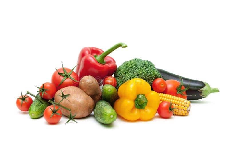 Rijpe verse die groenten op witte dichte omhooggaand worden geïsoleerd als achtergrond royalty-vrije stock afbeeldingen
