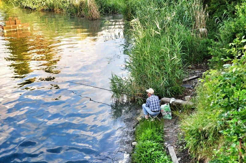 Rijpe visser stock afbeelding