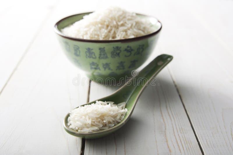 Rijst in een Chinese Groene Kom en een Lepel royalty-vrije stock afbeeldingen