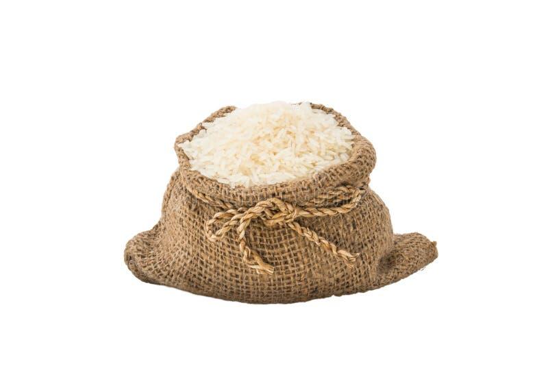 Rijst in geïsoleerde jutezak stock fotografie