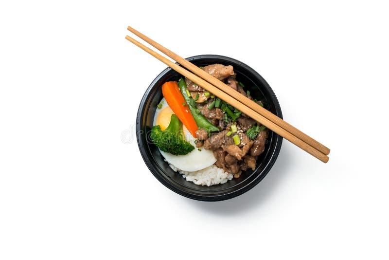 Rijst met gebraden varkensvlees en gebraden ei stock foto's