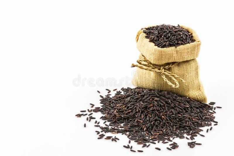 Rijstbes in kleine jutezak royalty-vrije stock foto