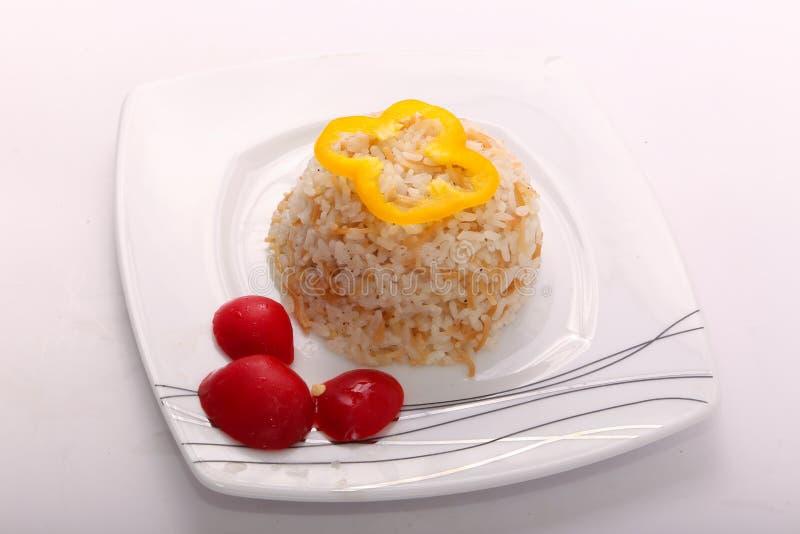 Rijstmaaltijd met plak van gele groene paprika royalty-vrije stock foto
