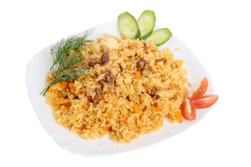 Rijstpilau met vleeswortel en ui op wit wordt geïsoleerd dat stock foto's