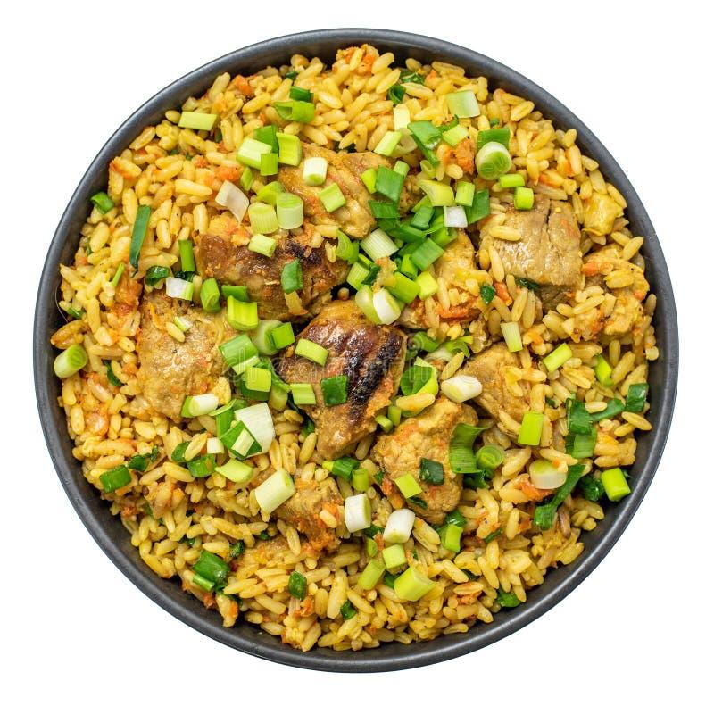 Rijstpilau met vleeswortel en uikom Geïsoleerdj op witte achtergrond Hoogste mening stock fotografie