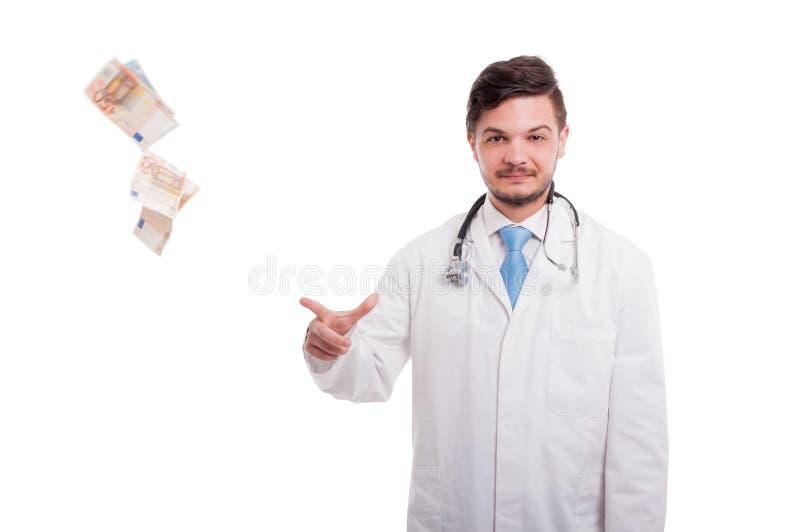 Rika manliga doktorsdroppbancknotes av euroet fotografering för bildbyråer