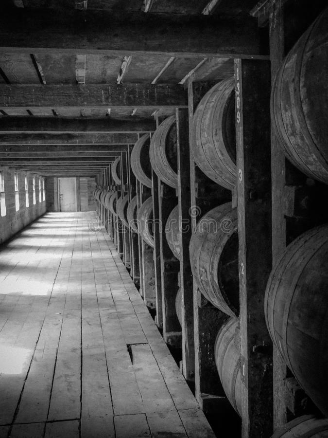 Rikhouse Barrel of Bourbon Kentucky. Black and White Photo of inside of rikhouse of kentucky bourbon royalty free stock images