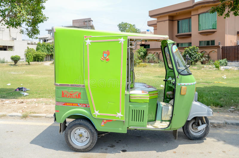 Rikshaw as a public transport in Lahore, Pakistan. Green Color Rikshaw in the historical city of Pakistan, Lahore royalty free stock photos
