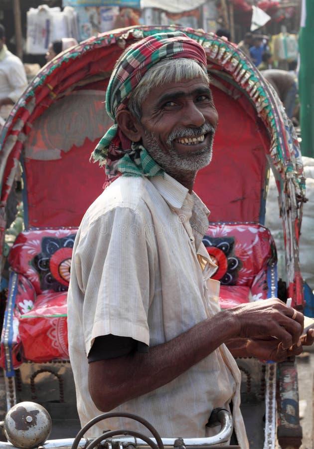Rikshaw szczęśliwa Ciągarka zdjęcia stock