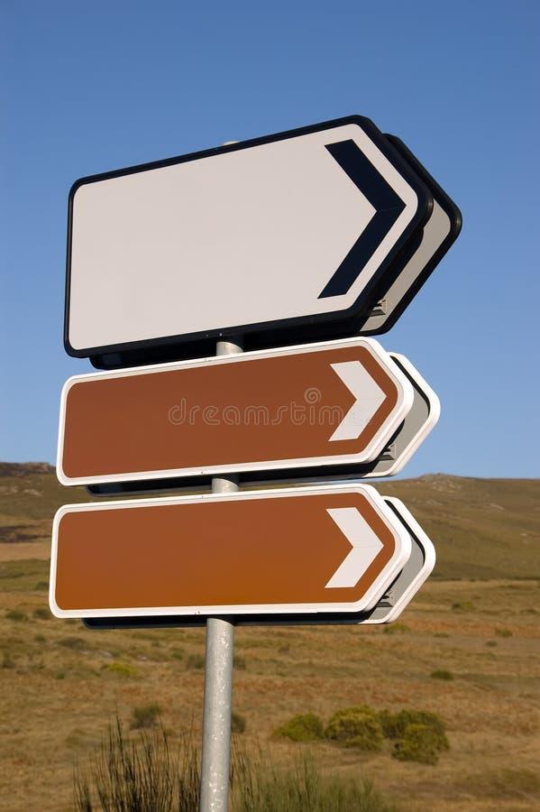 riktningstecken arkivbilder
