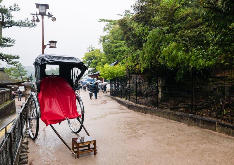 Rikusha & x28;rickshaw& x29; on Miyajima Island. Miyajima island is a famous island shrine-town is a UNESCO World Heritage Site and a major tourism destination stock photos