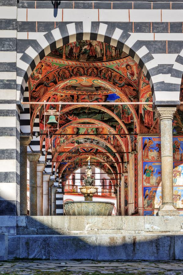 Rila monastery fountain and bell side view. Beautiful view of the vibrant decoration of the Orthodox Rila Monastery, a famous tourist attraction and cultural royalty free stock images