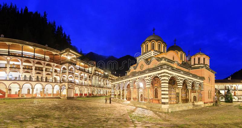 Rila monastery panorama at night. Beautiful panoramic panorama at night of the Orthodox Rila Monastery, a famous tourist attraction and cultural heritage stock images