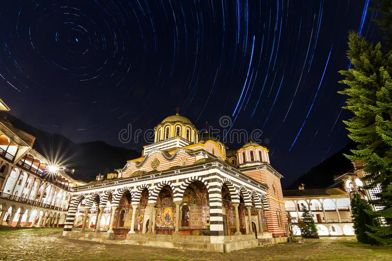 Rila monastery startrails. Beautiful view of the Orthodox Rila Monastery, a famous tourist attraction and cultural heritage monument in the Rila Nature Park stock photo