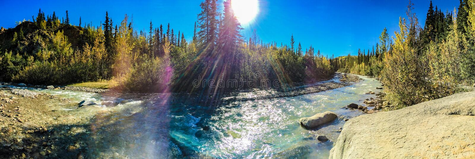 Riley Creek Alaska. Denali, Alaska, USA: Sept. 3, 2016: Panorama of Riley Creek in the sunshine. Creek is located near the entrance to Denali National Park in stock photo