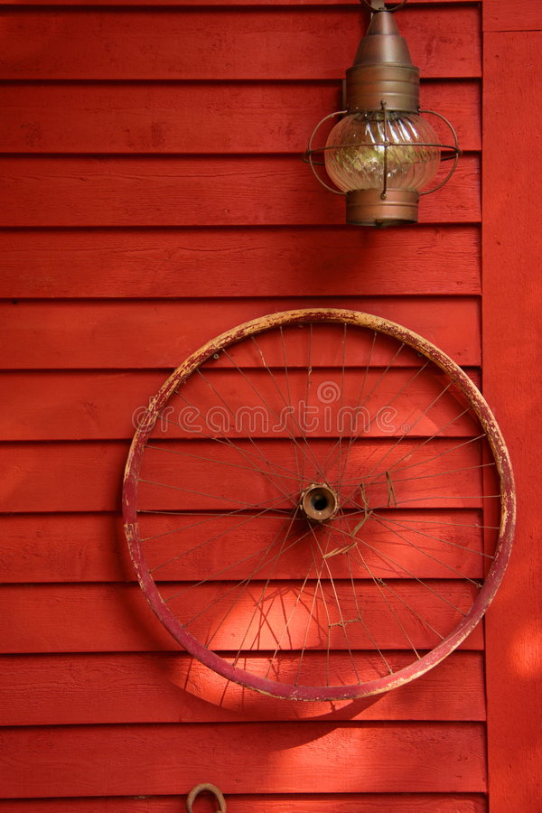 Rim on Wall. Old bicycle rim hanging as a decoration on wall of historic building royalty free stock images