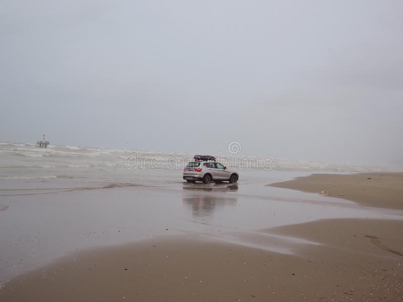 Rimini beach and car ride through the sea. Background with sea and car stock images