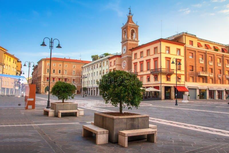 Rimini cityscape, Italy. Central square of Rimini. Square of the Three Martyrs in Rimini with ancient clock tower. Rimini cityscape, Italy. Central square of stock images