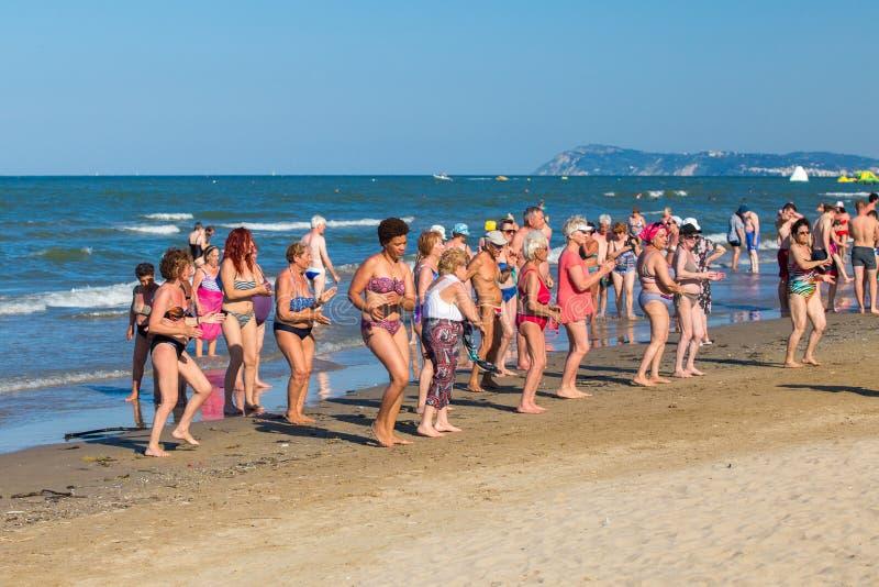 Group of elder people on Rimini seashore royalty free stock photo