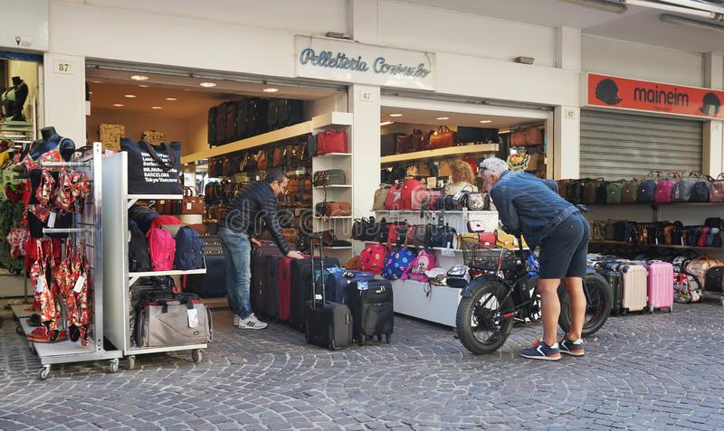 Small street shop selling different bags and suitcases. RIMINI, ITALY, SEPTEMBER 23, 2019. Small street shop selling different bags and suitcases stock photo