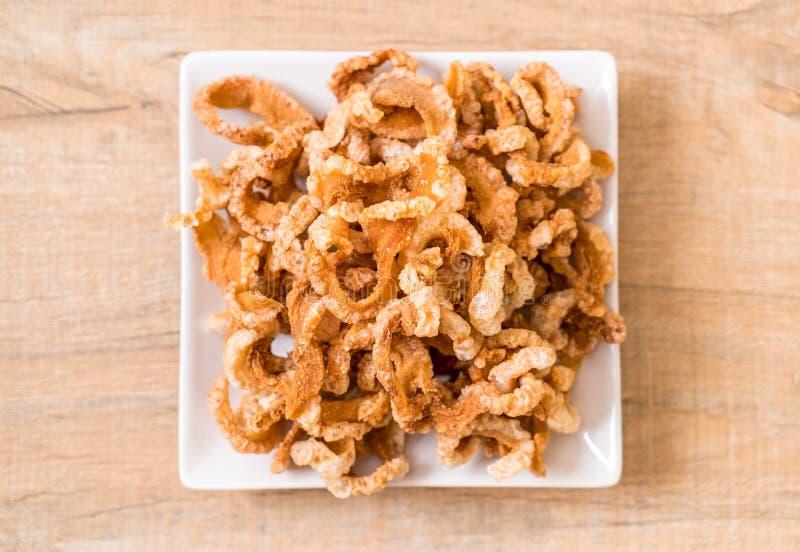 Rince de porc ou casse-croûte frit de porc avec les piments verts thaïlandais du nord D photographie stock