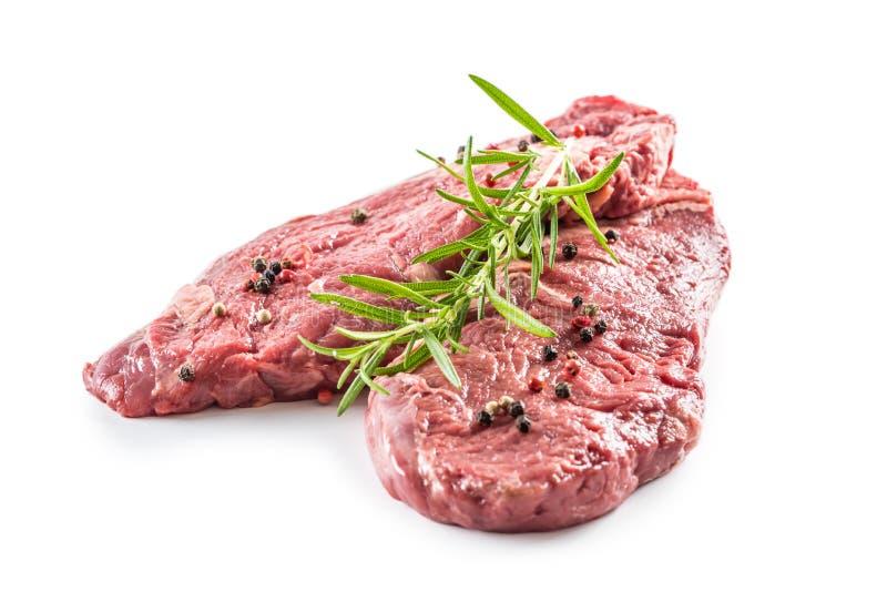 Rindfleisch meeat Rippe-Augensteakespritrosmarinsalz und -pfeffer lokalisiert auf Weiß lizenzfreies stockfoto