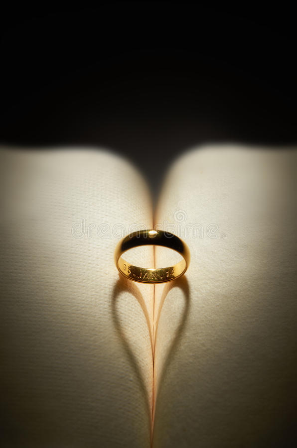 Ring. Wedding ring with mood lighting on love shadow stock photo
