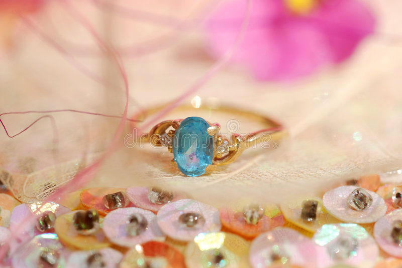 Ring. A gold ring with blue topaz stock image