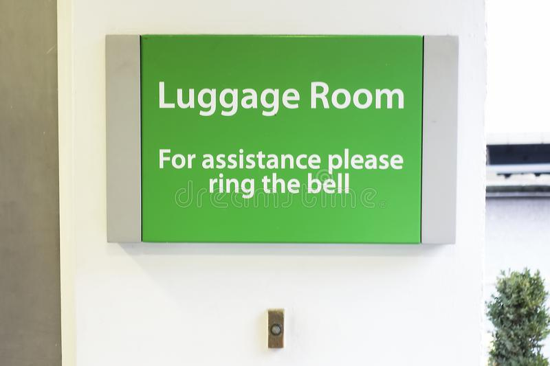 Ring bell for assistance luggage room hotel sign stock image