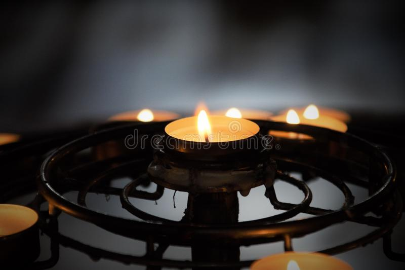 Ring of Bright Candles. A ring of Candles inside Notre Dame in Paris royalty free stock images