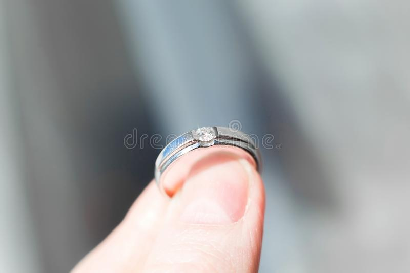 Ring with brilliant in fingers royalty free stock images