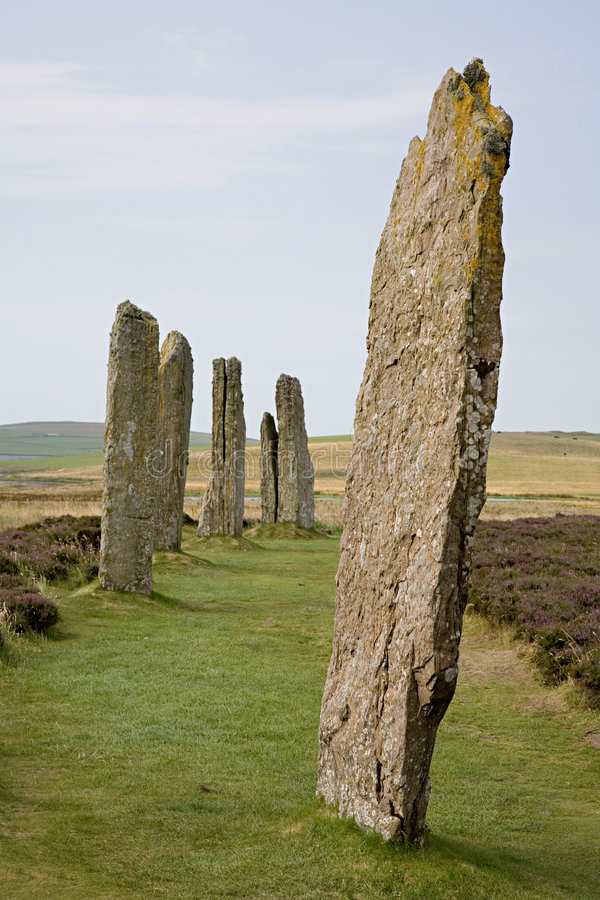 Ring of Brodgar. Vertical format image of standing stones in the Ring of Brodgar, selective focus on the major foreground stone. Part of the UNESCO Heart of royalty free stock photo