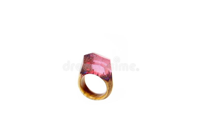 Ring epoxy and wood on a white background stock photo