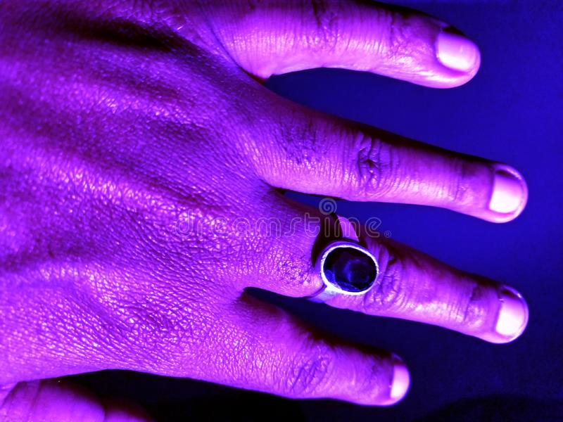 Ring with gomed nug in  hand stock photos