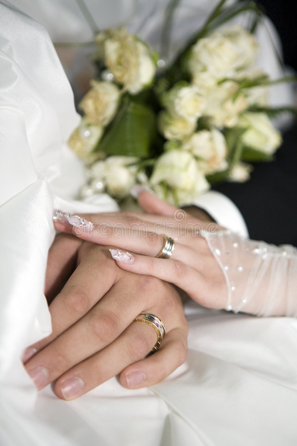 Ring & hands over white and flowers stock photography