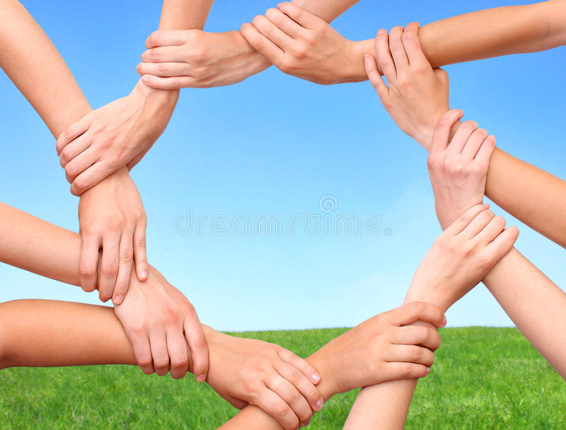 Ring of hands teamwork showing your product royalty free stock image