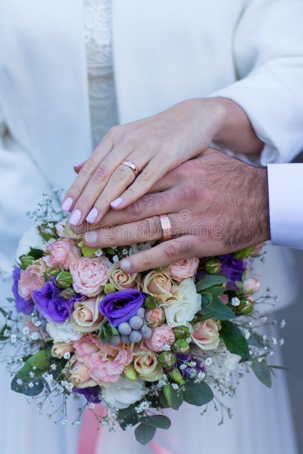 Two Ring, two hands, Wedding and engagement bouquet royalty free stock image