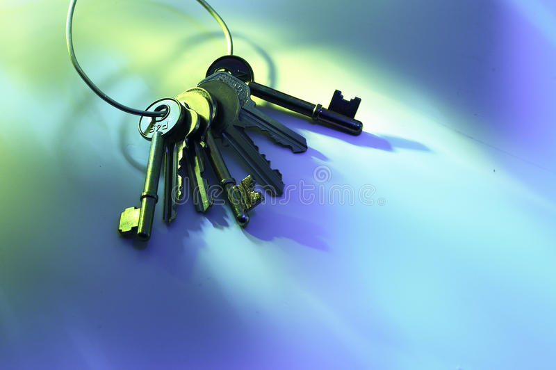 Ring of Keys. A ring of keys against a blue green background royalty free stock photo