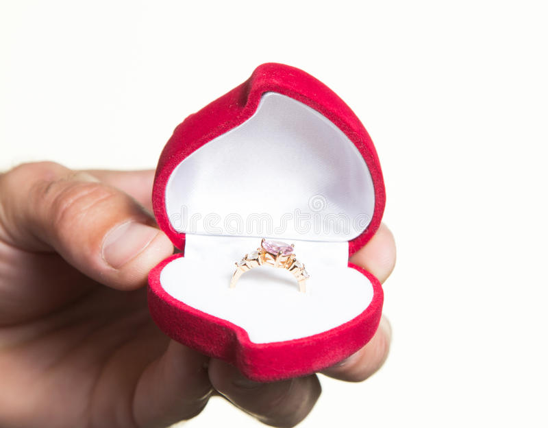 Ring in an open box in a man's hand, the proposal - isolate stock photography