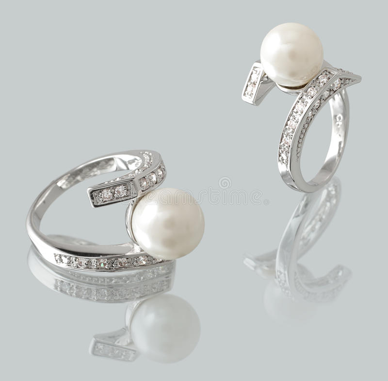 Ring with pearl stock images