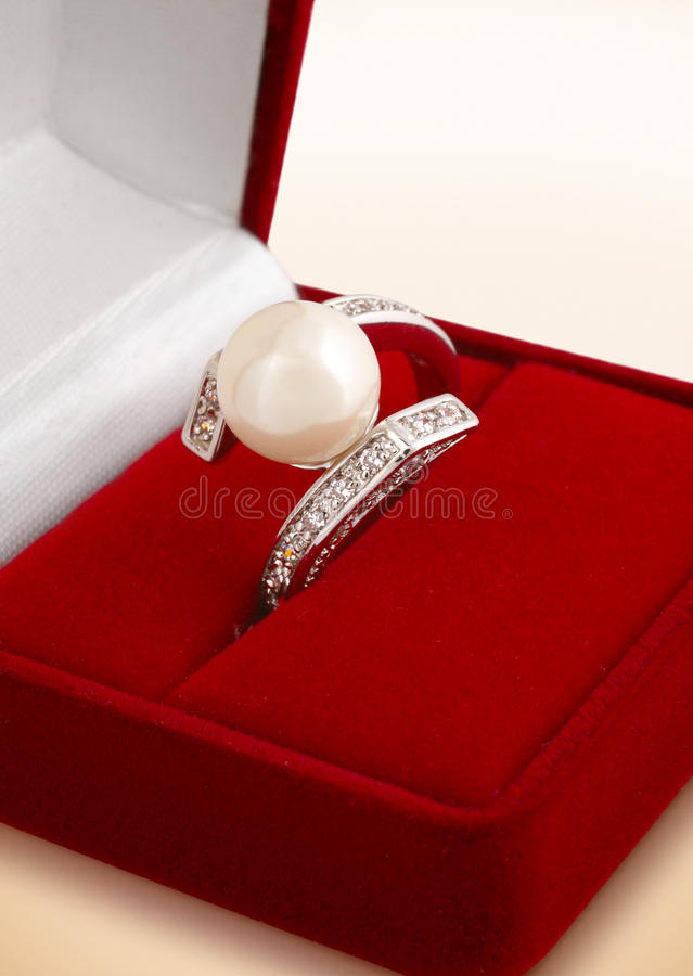 Ring with pearl in gift box royalty free stock photos
