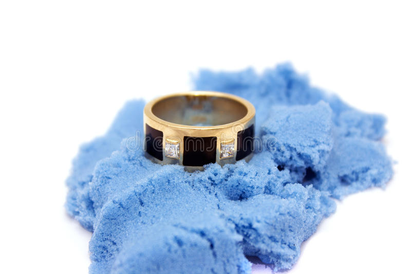 Ring on sand stock photography