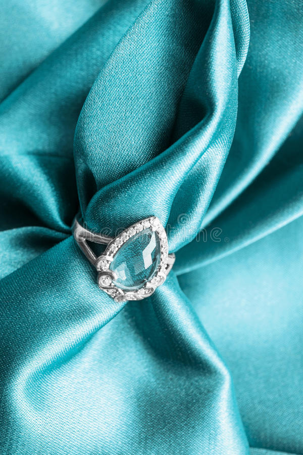 Ring on satin stock images