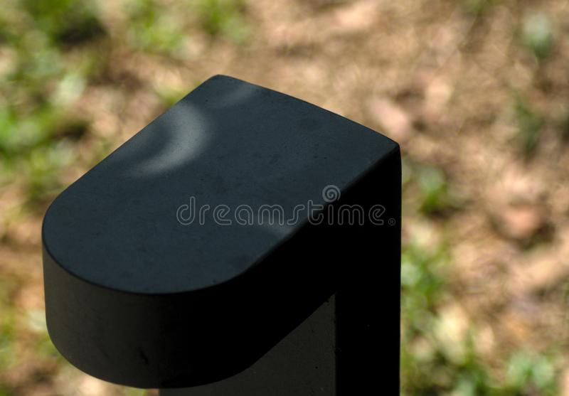 Ring shadow on a lamp during annular solar eclipse in johor bahru stock images