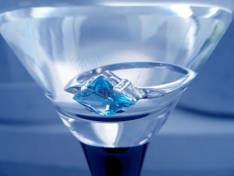 Ring in tumbler. Present.Ring with sapphire in tumbler stock photo