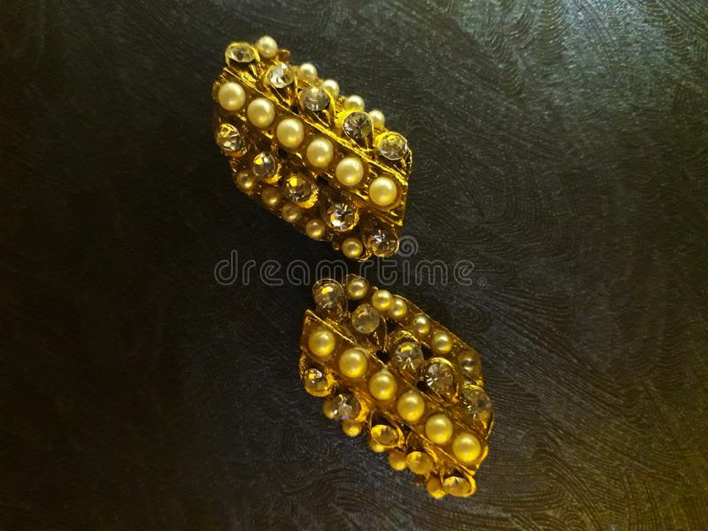 The ring of the two ring of diamond pearls on the beige of brown color stock photo